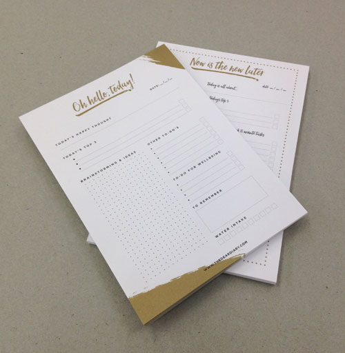Gold and black printed notepads